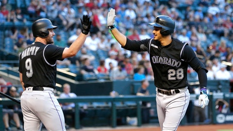 <p>               Colorado Rockies' Nolan Arenado celebrates with Daniel Murphy (9) after hitting a two run homerun against the Arizona Diamondbacks in the first inning during a baseball game, Tuesday, June 18, 2019, in Phoenix. (AP Photo/Rick Scuteri)             </p>