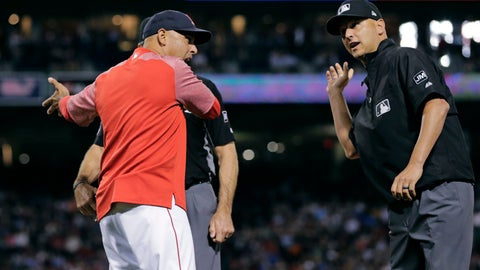 <p>               Boston Red Sox manager Alex Cora, left, is ejected by umpire Vic Carapazza, right, after arguing the ejection of Andrew Benintendi during the fifth inning of a baseball game against the Texas Rangers at Fenway Park in Boston, Tuesday, June 11, 2019. (AP Photo/Charles Krupa)             </p>