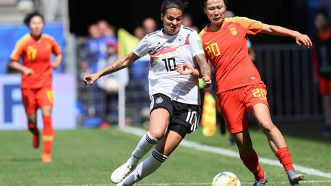 <p>               Germany's Dzsenifer Marozsan, left, and China's Zhang Rui fight for the ball during the Women's World Cup Group B soccer match between Germany and China, at the Roazhon Park stadium, in Rennes, France, Saturday, June 8, 2019. (AP Photo/David Vincent)             </p>