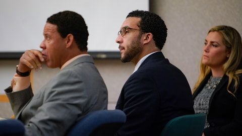 <p>               Sitting in Superior Court in Vista, Kellen Winslow, Jr., is flanked by two of his three defense attorneys, Brian Watkins, left, and Elizabeth Bahr, right, as he listens to closing arguments to jury from Deputy District Attorney, Dan Owens on Tuesday, June 4, 2019, in Vista, Calif.  (Nelvin C. Cepeda/The San Diego Union-Tribune via AP, Pool)             </p>