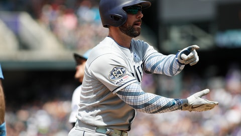 <p>               San Diego Padres' Greg Garcia gestures to the dugout after hitting a triple to drive in two runs off Colorado Rockies starting pitcher Peter Lambert in the third inning of a baseball game Sunday, June 16, 2019, in Denver. (AP Photo/David Zalubowski)             </p>