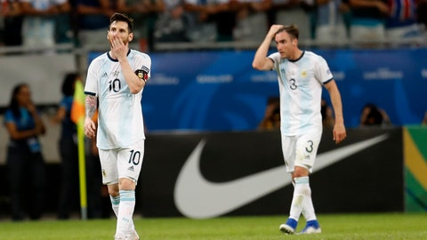 <p>               Argentina's Lionel Messi, left, and Argentina's Nicolas Tagliafico walk out of the pitch at the end of the Copa America Group B soccer match against Colombia at the Arena Fonte Nova in Salvador, Brazil, Saturday, June 15, 2019. Colombia won 2-0. (AP Photo/Natacha Pisarenko)             </p>