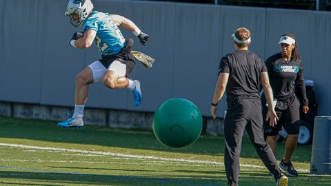 <p>               Carolina Panthers running back Christian McCaffrey jumps over a ball during an NFL football team practice in Charlotte, N.C., Tuesday, June 11, 2019. (AP Photo/Nell Redmond)             </p>