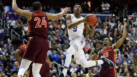 <p>               FILE - In this March 29, 2019, file photo, Duke forward RJ Barrett (5), from Canada,  drives to the basket past Virginia Tech forward Kerry Blackshear Jr. (24) and guard Ahmed Hill (13) during the second half of an NCAA men's East Regional semifinal college basketball game, in Washington. The NBA Draft is an event that has had an international flavor for years. (AP Photo/Alex Brandon, File)             </p>