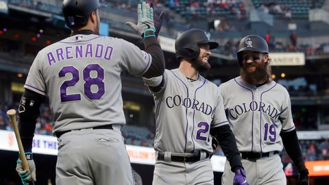 <p>               Colorado Rockies' David Dahl, center, is congratulated by Nolan Arenado, left, after hitting a two-run home run that also scored Charlie Blackmon, right, during the third inning of a baseball game against the San Francisco Giants in San Francisco, Monday, June 24, 2019. (AP Photo/Jeff Chiu)             </p>