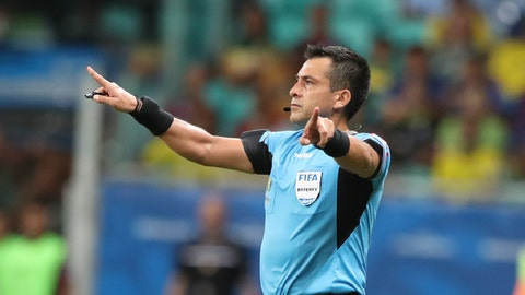 <p>               Referee Julio Bascunan disallows a goal scored by Brazil's Gabriel Jesus after consulting the VAR during a Copa America Group A soccer match at the Arena Fonte Nova in Salvador, Brazil, Tuesday, June 18, 2019. (AP Photo/Ricardo Mazalan)             </p>