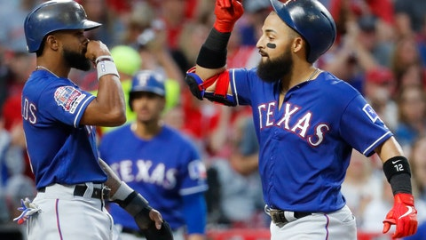 <p>               Texas Rangers' Rougned Odor, right, celebrates with Delino DeShields, left, after hitting a grand slam off Cincinnati Reds relief pitcher Wandy Peralta in the fifth inning of a baseball game, Friday, June 14, 2019, in Cincinnati. (AP Photo/John Minchillo)             </p>