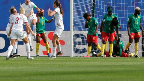 <p>               England's Steph Houghton, third from left, celebrates with teammates after scoring her side's first goal during the Women's World Cup round of 16 soccer match between England and Cameroon at the Stade du Hainaut stadium in Valenciennes, France, Sunday, June 23, 2019. (AP Photo/Michel Spingler)             </p>