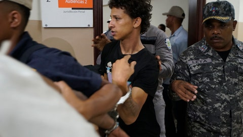 <p>               In this June 13, 2019 file photo Rolfy Ferreyra Cruz, center, is taken to court by police in Santo Domingo, Dominican Republic. The suspect in the shooting of former baseball star David Ortiz has been charged with drug and firearm possession in New Jersey. The U.S. attorney's office in Newark announced the indictment Thursday, June 20, 2019 for Rolfy Ferreyra Cruz. (AP Photo/Roberto Guzman, file)             </p>