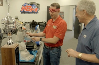 Kyle Busch shows Darrell Waltrip where he keeps his 200+ NASCAR trophies