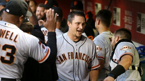 <p>               San Francisco Giants' Alex Dickerson, middle, celebrates his grand slam against the Arizona Diamondbacks with hitting coach Alonzo Powell, left, and Stephen Vogt, right, during the third inning of a baseball game Friday, June 21, 2019, in Phoenix. (AP Photo/Ross D. Franklin)             </p>
