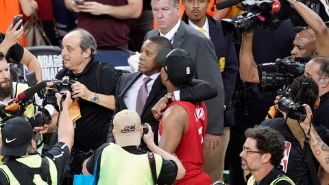 <p>               This Thursday, June 13, 2019, photo shows Toronto Raptors general manager Masai Ujiri, center left, walking with guard Kyle Lowry after the Raptors defeated the Golden State Warriors in Game 6 of basketball's NBA Finals in Oakland, Calif. Authorities say they are investigating whether Toronto Raptors president Masai Ujiri pushed and hit a sheriff's deputy in the face as he tried to get on the court after his team won the NBA title in Oakland. (AP Photo/Tony Avelar)             </p>