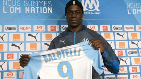 <p>               FILE - In this file photo dated Wednesday, Jan. 23, 2019, Olympique Marseille's new player Mario Balotelli poses during a press conference, at the club's headquarters of La Commanderie, in Marseille, southern France. The French club Marseille, is out of European competition after a fifth-place finish in Ligue 1, despite an attack that includes Mario Balotelli, and now Marseille must pay UEFA 2 million euros ($2.24 million) for breaking financial fair play rules, according to a UEFA announcement Wednesday June 19, 2019. (AP Photo/Claude Paris, FILE )             </p>