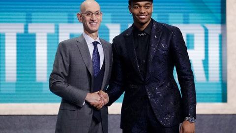 <p>               NBA Commissioner Adam Silver, left, poses for photographs with Kentucky's PJ Washington, after the Charlotte Hornets selected him as the 12th pick overall pick in the NBA basketball draft Thursday, June 20, 2019, in New York. (AP Photo/Julio Cortez)             </p>