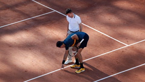"""<p>               In this Saturday, June 1, 2019, image, Argentina's Juan Martin del Potro points as he argues with umpire Manuel Absolu of France over whether a ball was in or out, during their third round match of the French Open tennis tournament at the Roland Garros stadium in Paris. There's a bit of choreography on clay seen at the French Open whenever a player disagrees with a line call. The chair umpire clambers down to the court, speed-walks over to locate the mark, thinks about it, then renders judgment, by holding an index finger aloft to indicate """"Out"""" or holding a palm flat to indicate """"In."""" (AP Photo/Pavel Golovkin)             </p>"""