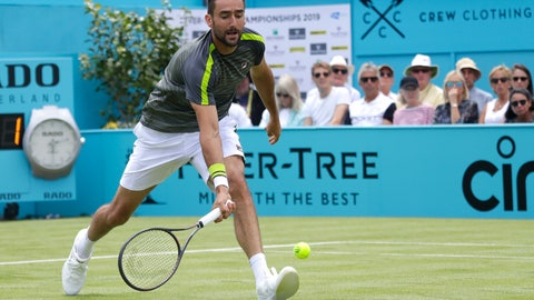<p>               Marin Cilic of Croatia plays a return to Cristian Garin of Chile during their singles match at the Queens Club tennis tournment in London, Monday, June 17, 2019. (AP Photo/Kirsty Wigglesworth)             </p>