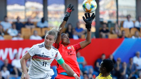 <p>               South Africa goalkeeper Andile Dlamini, center, catches the ball against Germany's Alexandra Popp during the Women's World Cup Group B soccer match between South Africa and Germany at the Stade de la Mosson in Montpellier, France, Monday, June 17, 2019. (AP Photo/Claude Paris)             </p>