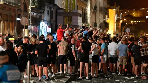 <p>               English supporters drink and sing on Friday, June 7, 2019 in the city center of Porto, Portugal, the day after England lost their UEFA Nations League semifinal soccer match against the Netherlands. England will play Switzerland in a third place play-off match on upcoming Sunday. (AP Photo/Martin Meissner)             </p>