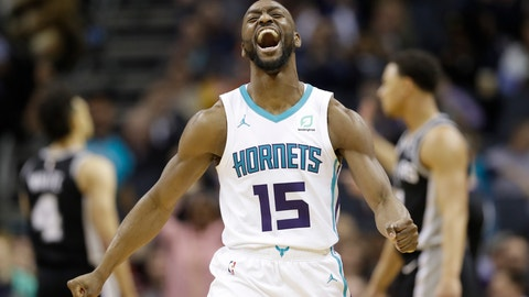 """<p>               FILE - In this March 26, 2019, file photo, Charlotte Hornets' Kemba Walker (15) reacts after making a basket against the San Antonio Spurs during the second half of an NBA basketball game in Charlotte, N.C. The three-time All-Star point says he'd be willing to work with the Hornets and take less than the """"supermax"""" $221 million contract he's eligible to receive to re-sign with Charlotte (AP Photo/Chuck Burton, File)             </p>"""