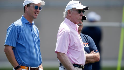 <p>               Former NFL quarterbacks Peyton Manning, left, and his father, Archie watch the Denver Broncos take part in drills at the team's NFL football training facility Wednesday, June 5, 2019, in Englewood, Colo. (AP Photo/David Zalubowski)             </p>