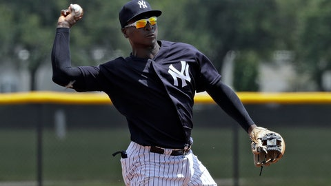 <p>               FILE - In this May 20, 2019, file photo, New York Yankees' Didi Gregorius throws the ball to first base in time to get a runner during a Gulf Coast League baseball game, in Tampa, Fla. Gregorius is back at shortstop for the New York Yankees, who are winning despite a slew of major injuries. Gregorius had Tommy John surgery in October, shortly after he injured his right elbow in the playoffs against Boston. (AP Photo/Chris O'Meara, File)             </p>