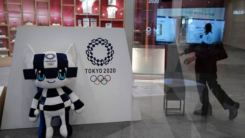 <p>               Miraitowa, a mascot for the Tokyo 2020 Summer Olympics, is displayed at an Olympic Corner Tuesday, June 11, 2019, in Tokyo. Earlier, Tokyo Olympic organizers announced their gold, silver, and bronze medals would be made of discarded electronic devises. Now, they are going a step further. The podiums that athletes will mount to receive their medals next year in Tokyo will be made primarily of recycled household plastics.(AP Photo/Jae C. Hong)             </p>