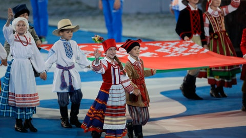 <p>               Children in national Belarusian costumes carry a state flag during the opening ceremony of the Second European Games in Minsk, Belarus, Friday, June 21, 2019. The event will run from June 21 to June 30. (AP Photo/Sergei Grits)             </p>