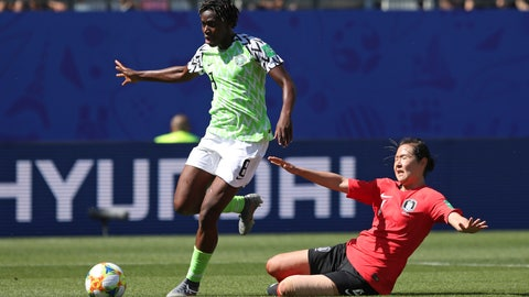<p>               Nigeria's Asisat Oshoala gets away from South Korea's Hwang Bo-ram on her way to scoring her side's second goal during the Women's World Cup Group A soccer match between Nigeria and South Korea in Grenoble, France, Wednesday June 12, 2019.(AP Photo/Laurent Cipriani)             </p>