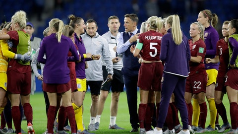 <p>               England head coach Philip Neville, center right talks to the players after the Women's World Cup Group D soccer match between England and Argentina at the Stade Oceane in Le Havre, France, Friday, June 14, 2019. (AP Photo/Alessandra Tarantino)             </p>