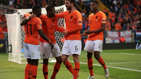 <p>               Netherlands' Quincy Promes, left, celebrates with teammates after scoring his side's third goal during the UEFA Nations League semifinal soccer match between Netherlands and England at the D. Afonso Henriques stadium in Guimaraes, Portugal, Thursday, June 6, 2019. (AP Photo/Luis Vieira)             </p>