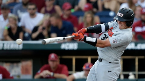 <p>               FILE  - In this June 28, 2018, file photo, Oregon State's Adley Rutschman hits an RBI single to score Cadyn Grenier during the third inning of Game 3 against Arkansas in the NCAA College World Series baseball finals, in Omaha, Neb. The Baltimore Orioles lead off the Major League Baseball Draft for the first time in 30 years and Oregon State catcher Adley Rutschman is a heavy favorite to be selected No. 1 on Monday night, June 3, 2019. (AP Photo/Nati Harnik, File)             </p>