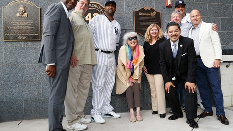 <p>               Representatives of the the Stonewall Inn and the New York Yankees, including pitcher CC Sabathia, third from left; relief pitcher Dellin Betances, second from right; assistant general manager Jean Afterman, center; and general manager Brian Cashman, right, honor the 50th anniversary of the Stonewall Inn Uprising after the Yankees unveiled a plaque in Monument Park before a baseball game Tuesday, June 25, 2019, in New York. Stonewall witness Tree Sequoia, second from left, and Stonewall owner co-owner Kurt Kelly, third from right, in front of Betances, joined the group. (AP Photo/Kathy Willens)             </p>