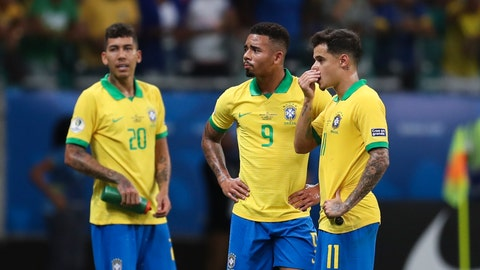 <p>               Brazil's Gabriel Jesus, center, waits for the referee to decide on his goal with teammates Brazil's Roberto Firmino, left, and Brazil's Philippe Coutinho, right, during a Copa America Group A soccer match at the Arena Fonte Nova in Salvador, Brazil, Tuesday, June 18, 2019. Referee Julio Bascunan, not in picture, annulled Gabriel Jesus' goal due to an offside position. (AP Photo/Natacha Pisarenko)             </p>