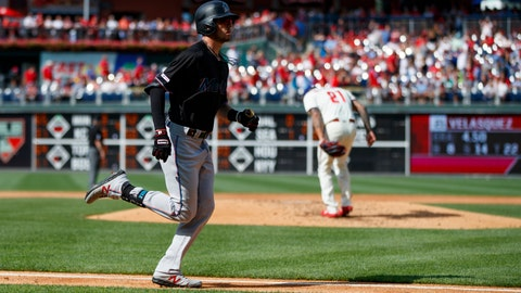 <p>               Miami Marlins' JT Riddle, left, rounds the bases past Philadelphia Phillies starting pitcher Vince Velasquez after hitting a home run during the third inning of a baseball game, Saturday, June 22, 2019, in Philadelphia. (AP Photo/Matt Slocum)             </p>