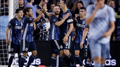 <p>               LA Galaxy forward Zlatan Ibrahimovic (9) celebrates with teammates after scoring a goal during the second half of an MLS soccer match against the Sporting Kansas City Wednesday, May 29, 2019, in Kansas City, Kan. LA Galaxy won 2-0. (AP Photo/Charlie Riedel)             </p>