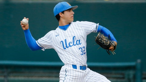 <p>               UCLA pitcher Ryan Garcia throws to a Michigan batter during the first inning of an NCAA college baseball tournament super regional game in Los Angeles, Friday, June 7, 2019. (AP Photo/Ringo H.W. Chiu)             </p>