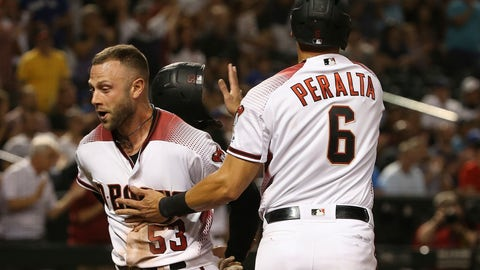 <p>               Arizona Diamondbacks' Christian Walker (53) and David Peralta (6) celebrate their runs scored against the Los Angeles Dodgers during the eighth inning of a baseball game, Monday, June 24, 2019, in Phoenix. (AP Photo/Ross D. Franklin)             </p>