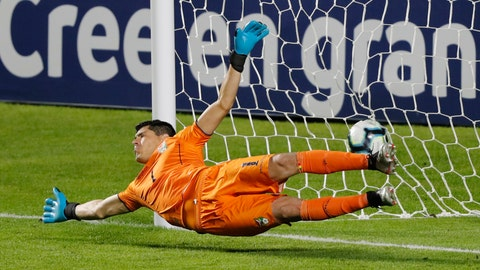 <p>               Bolivia's Carlos Lampe fails to stop a penalty from Brazil's Philippe Coutinho during a Copa America Group A soccer match at the Morumbi stadium in Sao Paulo, Brazil, Friday, June 14, 2019. (AP Photo/Nelson Antoine)             </p>