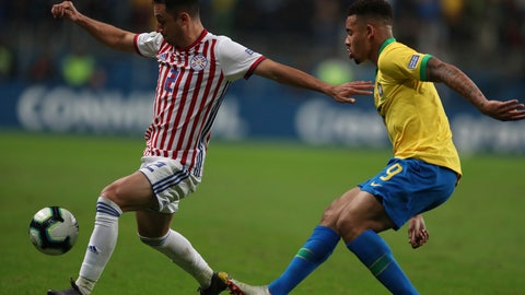 <p>               Paraguay's Ivan Piris, left, dribbles past Brazil's Gabriel Jesus during a Copa America quarterfinal soccer match at the Arena do Gremio in Porto Alegre, Brazil, Thursday, June 27, 2019. (AP Photo/Natacha Pisarenko)             </p>