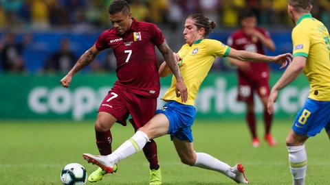 <p>               Brazil's Filipe Luis, center, vies for the ball with Venezuela's Darwin Machis, left, during a Copa America Group A soccer match at the Arena Fonte Nova in Salvador, Brazil, Tuesday, June 18, 2019. (AP Photo/Natacha Pisarenko)             </p>