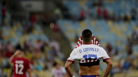 <p>               Paraguay's Derlis Gonzalez covers his face after his side's 2-2 draw with Qatar in a Copa America Group B soccer match at the Maracana stadium in Rio de Janeiro, Brazil, Sunday, June 16, 2019. (AP Photo/Silvia Izquierdo)             </p>