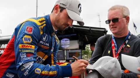 <p>               Alexander Rossi autographs caps after qualifying for the pole for the first race of the IndyCar Detroit Grand Prix auto racing doubleheader, Saturday, June 1, 2019, in Detroit. (AP Photo/Carlos Osorio)             </p>