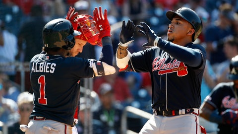 <p>               Atlanta Braves' Johan Camargo, right, and Ozzie Albies celebrate after Camargo batted Albies in on a two-run home run in the 10th inning of a baseball game against the Washington Nationals, Sunday, June 23, 2019, in Washington. (AP Photo/Patrick Semansky)             </p>