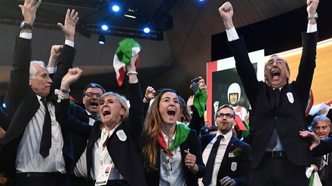 <p>               Members of Milan-Cortina delegation celebrate after winning the bid to host the 2026 Winter Olympic Games, during the first day of the 134th Session of the International Olympic Committee (IOC), at the SwissTech Convention Centre, in Lausanne, Switzerland, Monday, June 24, 2019. Italy will host the 2026 Olympics in Milan and Cortina d'Ampezzo, taking the Winter Games to the Alpine country for the second time in 20 years. (Philippe Lopez/Pool via AP)             </p>
