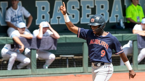 <p>               Auburn's Ryan Bliss (9) scores on a run off a home run hit by teammate Edouard Julien during the ninth inning against North Carolina in Game 1 at the NCAA college baseball super regional tournament in Chapel Hill, N.C., Saturday, Jun 8, 2019. (AP Photo/Ben McKeown)             </p>