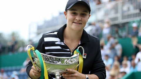 <p>               Australia's Ashley Barty poses with the trophy after beating Germany's Julia Goerges during the final match of the Nature Valley Classic at Edgbaston Priory Club in Birmingham, England, Sunday June 23, 2019. (Tim Goode/PA via AP)             </p>