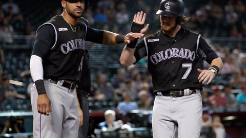 <p>               Colorado Rockies' Brendan Rodgers (7) and Ian Desmond celebrate after scoring on a base hit by Chris Iannetta during the 10th inning of the team's baseball game against the Arizona Diamondbacks, Thursday, June 20, 2019, in Phoenix. (AP Photo/Matt York)             </p>