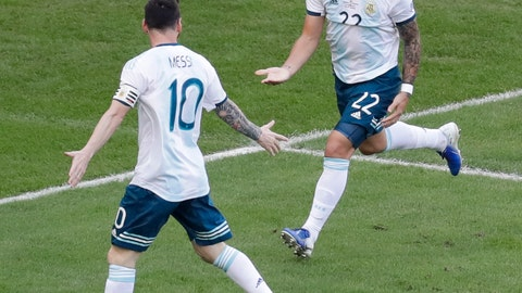 <p>               Argentina's Lautaro Martinez, right, celebrates scoring his side's opening goal with teammate Lionel Messi during a Copa America quarterfinal soccer match against Venezuela at the Maracana stadium in Rio de Janeiro, Brazil, Friday, June 28, 2019. (AP Photo/Silvia Izquierdo)             </p>