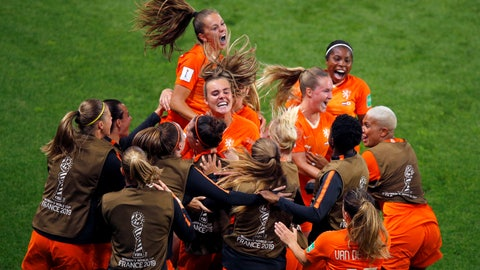 <p>               Netherlands' Lieke Martens, top, celebrates with teammates after scoring her team's second goal from the penalty spot during the Women's World Cup round of 16 soccer match between the Netherlands and Japan at Roazhon Park, in Rennes, France, Tuesday, June 25, 2019. (AP Photo/Francois Mori)             </p>