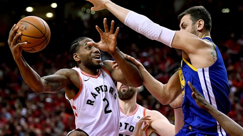 <p>               Toronto Raptors forward Kawhi Leonard (2) stretches to keep the ball from Golden State Warriors center Andrew Bogut (12) as he drives to the net during the second half of Game 2 of basketball's NBA Finals, Sunday, June 2, 2019, in Toronto. (Frank Gunn/The Canadian Press via AP)             </p>